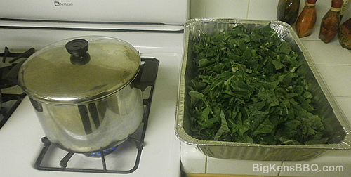 Uncooked collard greens next to pot on stove